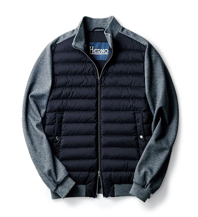 スポーティな異素材切り替えを採用したショートブルゾンは、今季注目の一着。前身頃のダウン素材に用いられるナイロンを、光沢を抑えたものに変更したビームスエクスクルーシブモデルです。袖は撥水性を備えるスウェット風素材であり、軽量かつ動きやすく、暖かいブルゾンに仕上がっています。かさばらないので、インナーとしても着回せます。